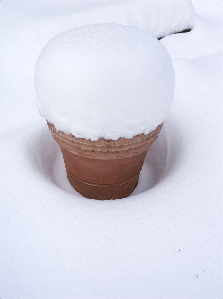 life_in_maine_garden_snow_pot